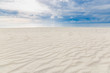 Yellow warm sand with natural texture and summer sea with sky and free space