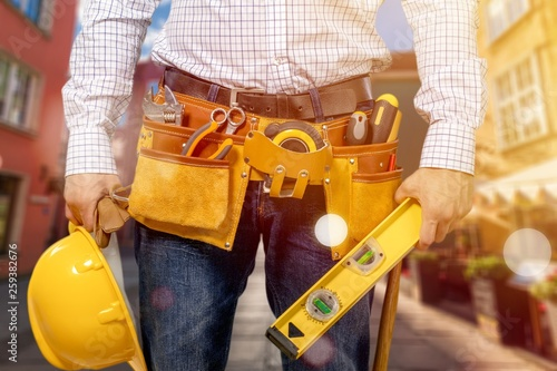 Carta da parati  Worker with a tool belt. Isolated over  background.