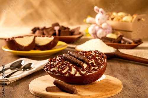 Fototapeta Gourmet easter egg, stuffed with cream and chocolate. Easter egg with pudding cream, Easter dessert. Easter concept. obraz