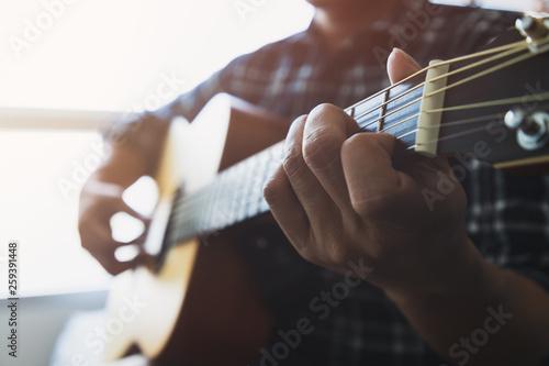 Valokuvatapetti Close up men wearing blue plaid shirts playing guitar
