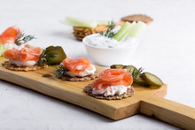 Party Food, Appetizer With Salmon Pate And Smoked Salmon On  Cutting Board