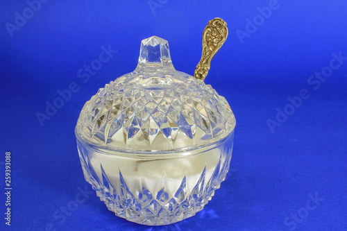 Fotografie, Obraz  Antique cut-glass crystal sugar bowl and antique sterling silver sugar spoon aga