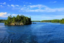 Peaceful Landscape Of The Thousand Islands During Summer With Bridge In Background Along Canadian American Border