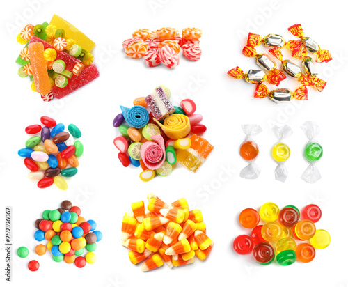 Set of different tasty candies on white background, top view