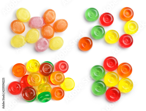 Fotografia  Set of colorful tasty hard candies on white background, top view