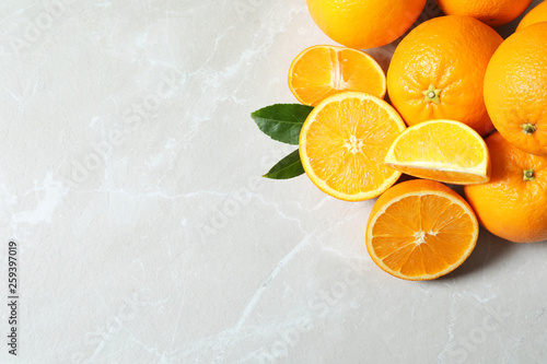 Flat lay composition with ripe oranges and space for text on light background
