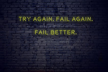 Positive Inspiring Quote On Neon Sign Against Brick Wall Try Again Fail Again Fail Better