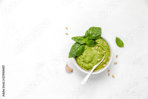 Pesto in white bowl, view from above Fototapeta