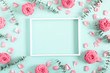 Leinwandbild Motiv Beautiful flowers composition. Blank frame for text, pink rose flowers, eucalyptus leaves on pastel mint background. Valentines Day, Easter, Birthday, Mother's day. Flat lay, top view, copy space