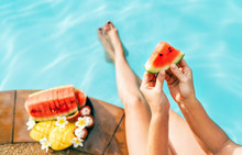 Woman Take In Hands Little Watermelon Piece, Sitting On The Pool Edge And Enjoing Fresh Fruits