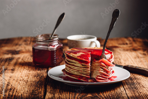 Valokuva  Stack of american pancakes with red berry jam