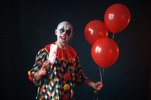 Bloody Clown With Meat Cleaver Holds Air Balloon
