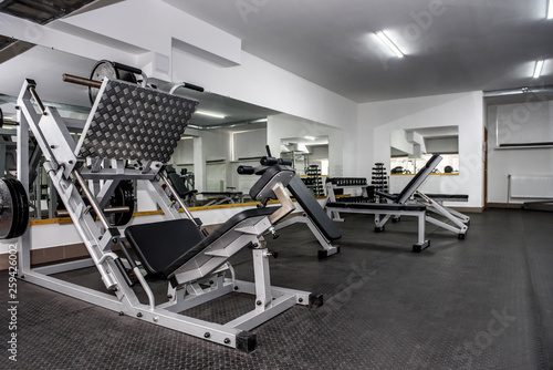 Fotografia  Modern and empty gym interior with equipment