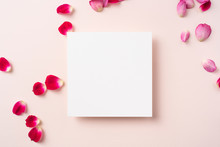 Top View Of Red Rose Petal With White Square Card