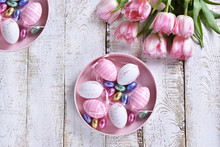 Easter Flat Lay With Painted Eggs And Pink Tulips