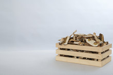 Sliced Dried Mushrooms In A Small Wooden Crate