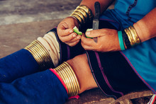 Woman's Hands And Legs In Bracelets Long Neck Tribal . Tribal Village Thailand.