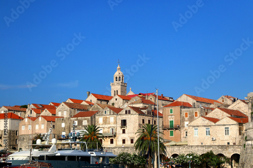 Fotografie, Obraz  Historic buildings and small boats in town Korcula, on island Korcula, Croatia
