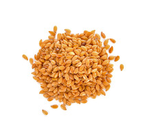 Golden Flax Seeds On A White B...