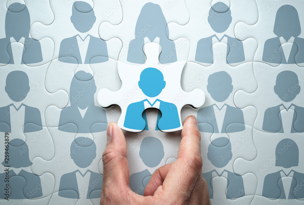 Fototapeta Selecting person and building team. Business people relationship concept.Connecting last jigsaw puzzle piece.