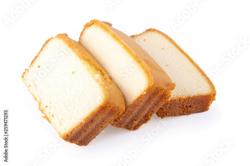 Tableau sur Toile Sliced moist butter cake isolated on white background.
