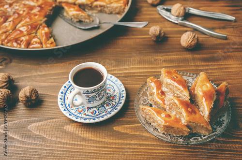 Slika na platnu Baklava with nuts on a wooden background. Selective focus.