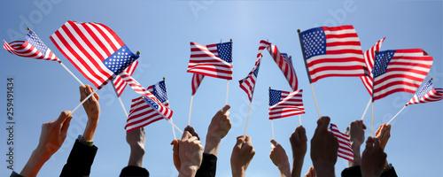 Fotografie, Tablou Group of People Waving American Flags over blue sky