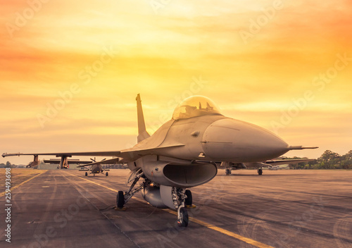 Photographie Fighter jet military aircraft parked on runway in the base airforce standby read