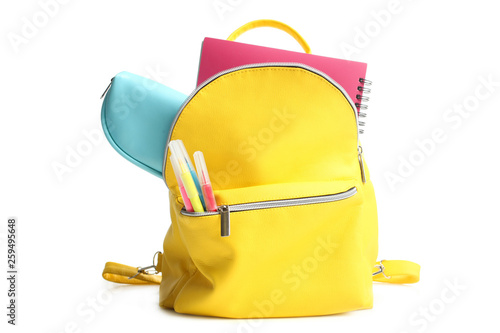 Photo yellow backpack with different school supplies