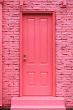 Pink Painted Door And Brick Wall