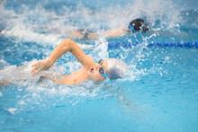 Boys Swimming  In Pool