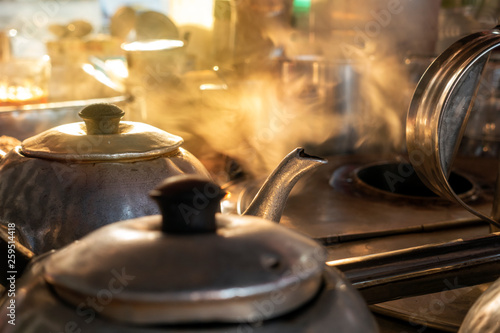 Fotografie, Obraz  A old fashion hot teapot with steam