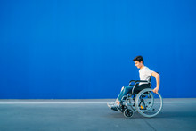 Portrait Of Young Man On Wheelchair
