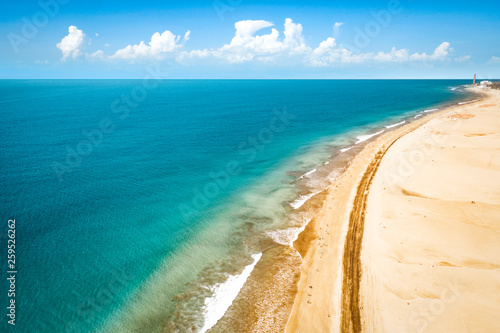 Aerial photo of summer beach and blue ocean with sky.