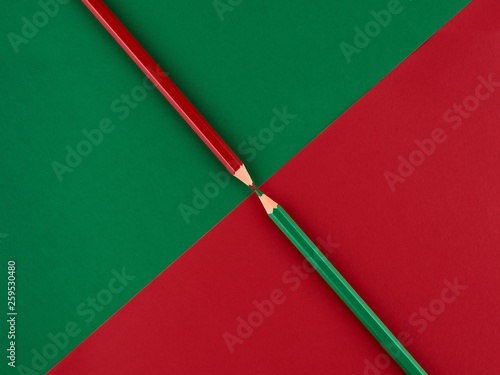 Red and green pencils on a contrasting background Canvas Print