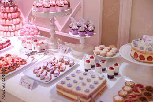 delicious candy bar with cupcakes and other candys