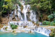 The Kuang Si Falls Or Known As Tat Kuang Si Waterfalls. These Waterfalls Are A Favorite Side Trip For Tourists In Luang Prabang With A Turquoise Blue Pool