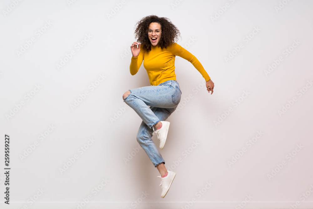 Fototapety, obrazy: Dominican woman with curly hair jumping over isolated white background