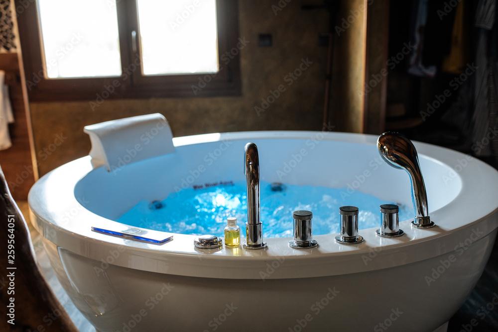 Fototapeta Modern beautiful hydro massage bath with water