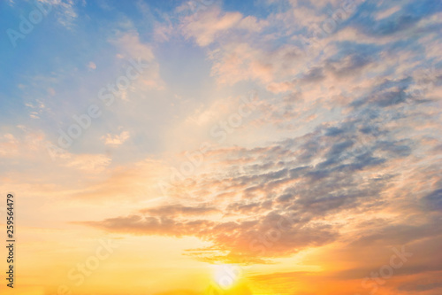 Fototapety, obrazy: Sky blue and orange light of the sun through the clouds in the sky