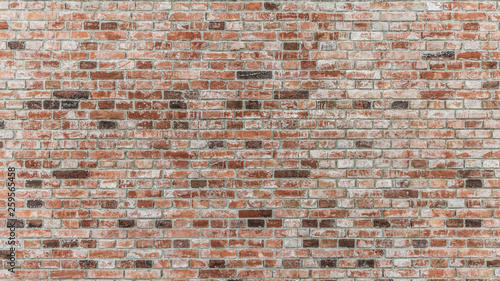 Fotografía  Brick wall of red color, old red brick wall texture background.