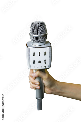 Fotografie, Obraz  Hand holding a Wireless Handheld Bluetooth Microphone with Speaker Audio Recording isolated on white background with clipping path
