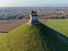 Aerial View Of The Lion's Mound With Farm Land Around.  The Immense Butte Du Lion On The Battlefield Of Waterloo Where Napoleon Died. Belgium