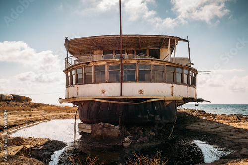 Old vintage abandoned rusted ship run aground after shipwreck accident in beginn Wallpaper Mural