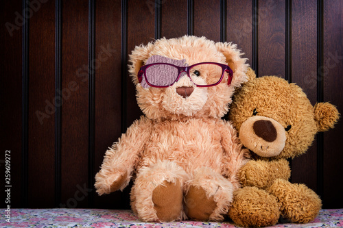 Canvas Print Teddy bear shows how to wear a patch to correct amblyopia; Children with lazy ey