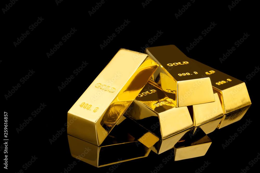 Fototapeta Shiny gold bars on black background. Space for text