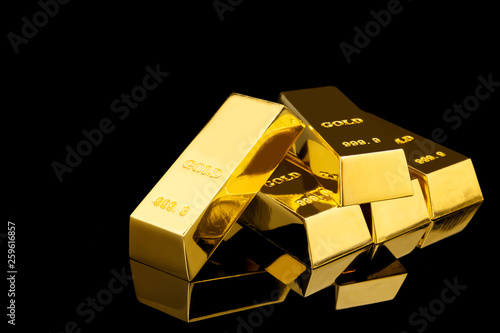 Obraz Shiny gold bars on black background. Space for text - fototapety do salonu