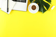 canvas print picture - Female blog writer workspace concept. Big green monstera palm leaf on femenine desktop composition. Background, close up, copy space, flat lay, top view.