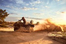 Racing In The Sand On A Four-w...