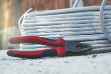 Pliers Laying Next To The Cabl...